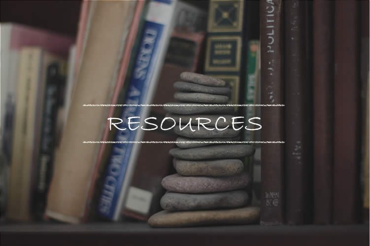 Link to resources page. Picture of cairn of rocks on a bookshelf.