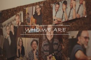Bulletin board with photos of community members. Links to Who We Are page.